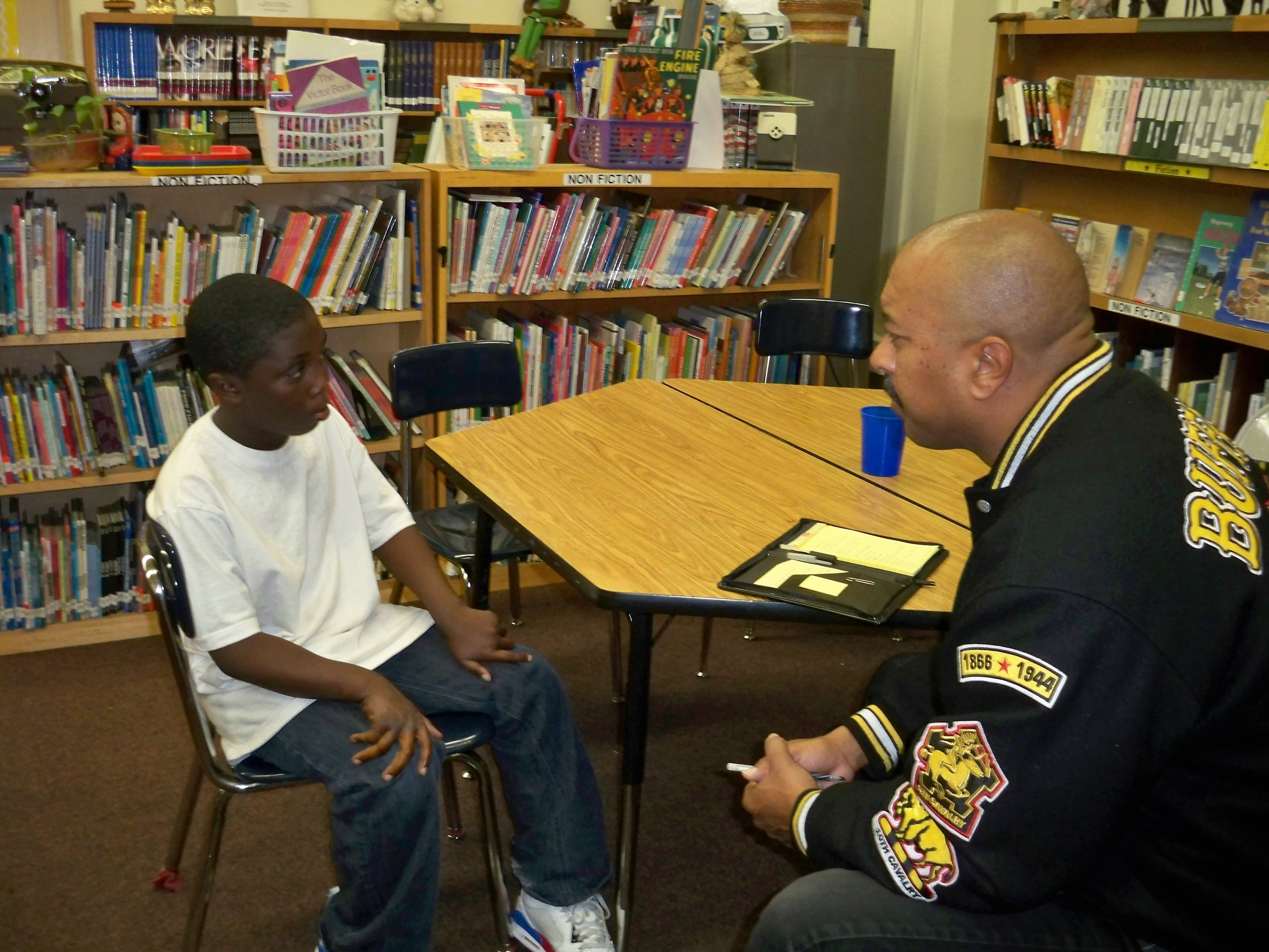 Brent F. Burton mentoring a young man at Barret Elementary School in South L.A.